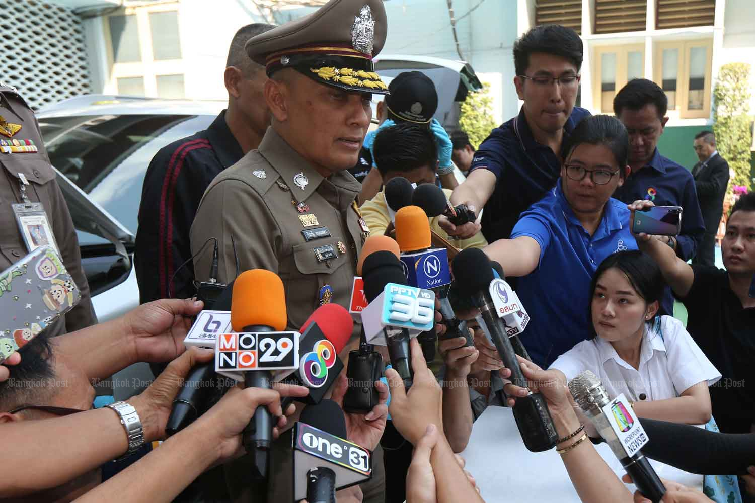 Deputy national police chief Pol Gen Wirachai Songmetta answers reporters' questions about the shots fired at Pol Lt Gen Surachate Hakparn's car, at the Royal Thai Police Office in Bangkok on Jan 9, defying national police chief Pol Gen Chakthip Chaijinda's order that he stay out of the case. (Photo by Varuth Hirunyatheb)