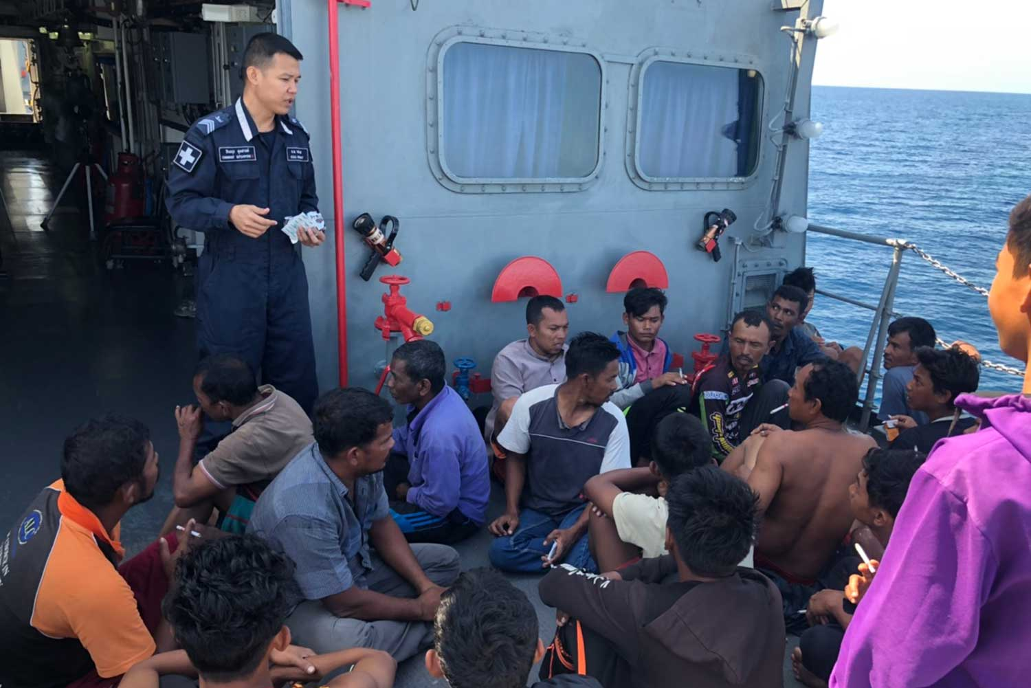 Crewmen and skippers on board two Indonesian fishing trawlers are detained for fishing illegally in Thai waters off Phangnga province on Tuesday morning. (Photo by Achadtaya Chuenniran)