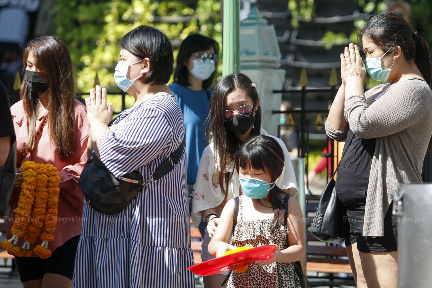 Chinese tourists pray at the Erawan Shrine in Bangkok on Tuesday. (Photo by Pattarapong Chatpattarasill)