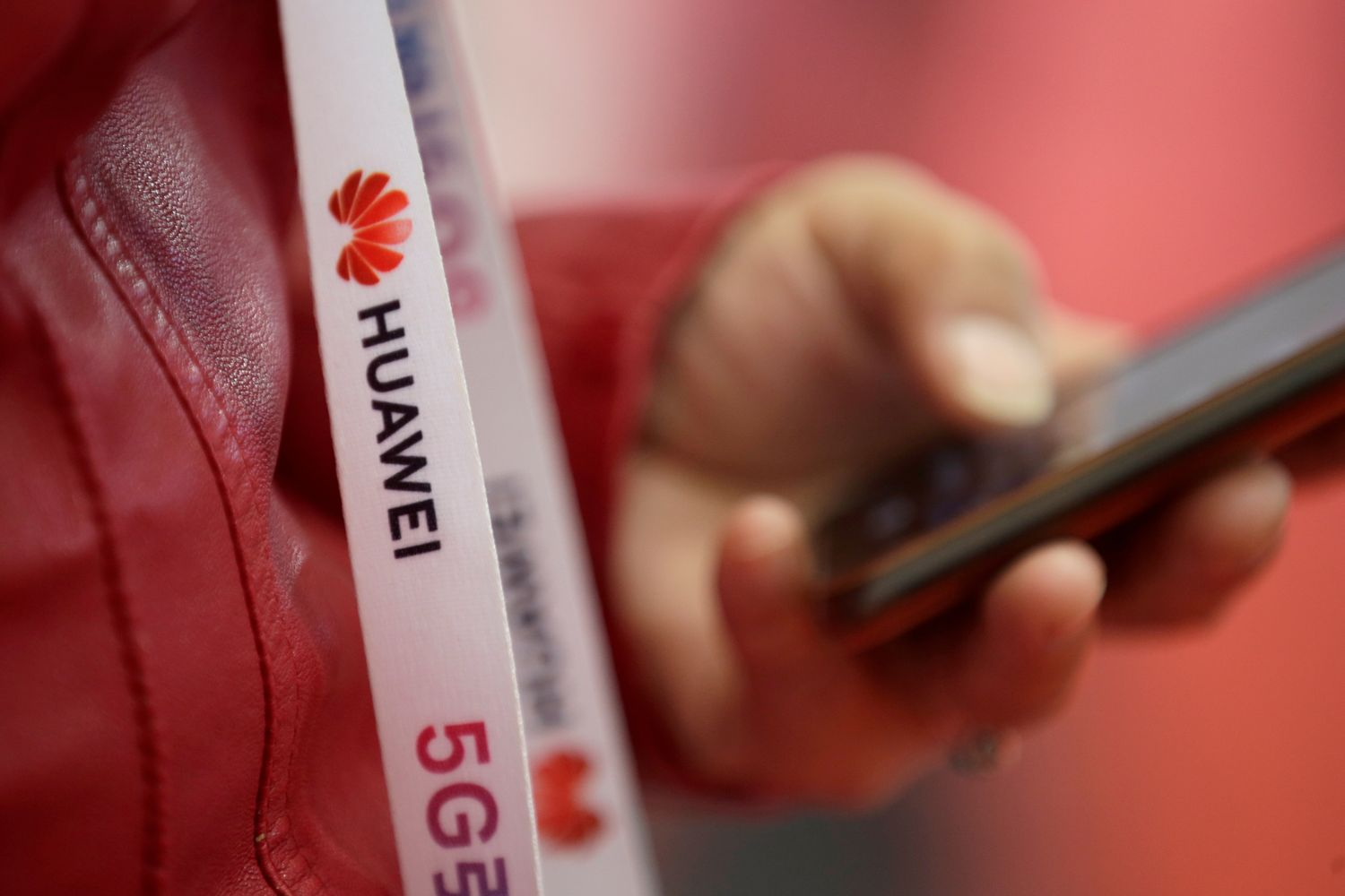 An attendee wears a badge strip with the logo of Huawei and a sign for 5G at the World 5G Exhibition in Beijing on Nov 22 last year. (Reuters photo)