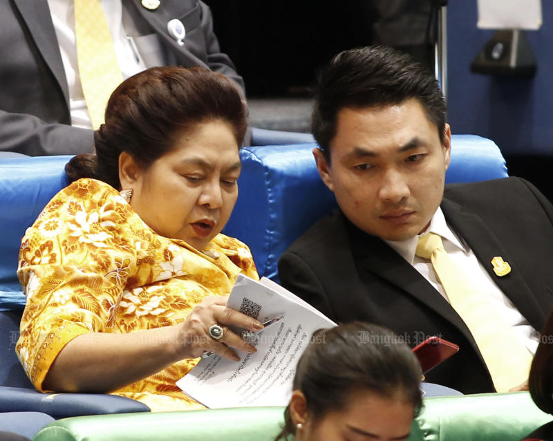 Bhumjaithai party-list MP Natee Ratchakitprakarn (left) talks to a party colleague in parliament on July 3, 2019. (Photo by Pattarapong Chatpattarasill)