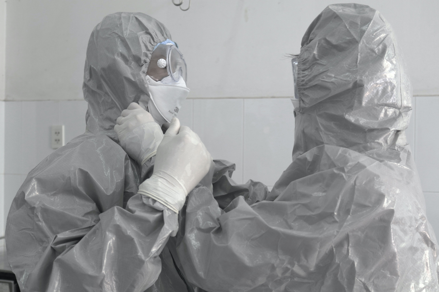 Doctors help each other put on protective suits before entering the isolation section at Cho Ray hospital in Ho Chi Minh City. Vietnam has confirmed six infections so far. (Reuters Photo)
