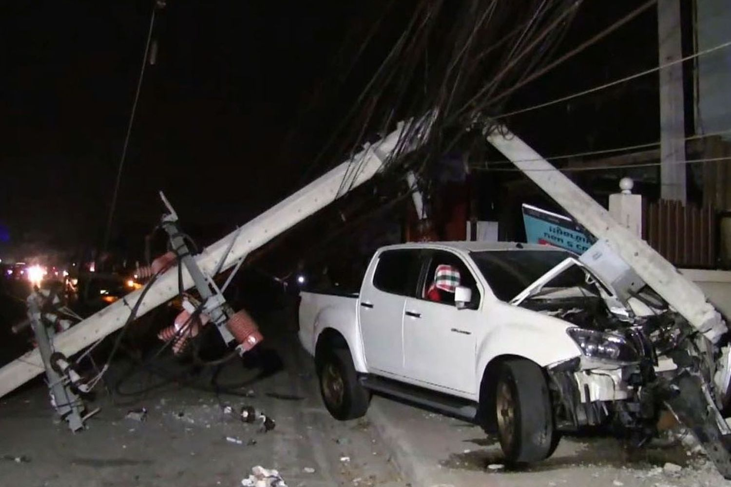 A pickup truck crashes into a power pole, bringing down four others, in Bang Sao Thong, district, Samut Prakan province, on Saturday night. (Photos supplied by Sutthiwit Chayutworakan)