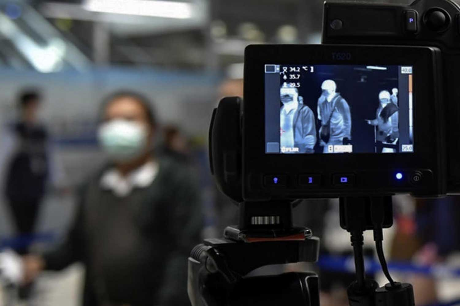 Air travellers being screened for a fever at Suvarnabhumi airport. Health authorities are seeking further details of a South Korean woman found infected with the coronavirus after arriving home from a visit to Thailand. (Photo suppled)