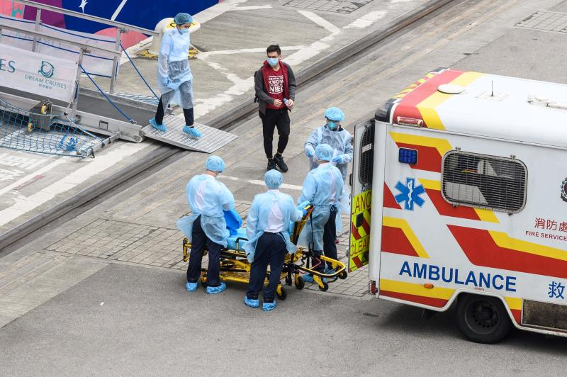 A man is transferred from the World Dream cruise ship to an ambulance at the Kai Tak cruise terminal in Hong Kong on Wednesday, as health officials conduct inspections in the wake of the SARS-like virus outbreak across China. (AFP photo)