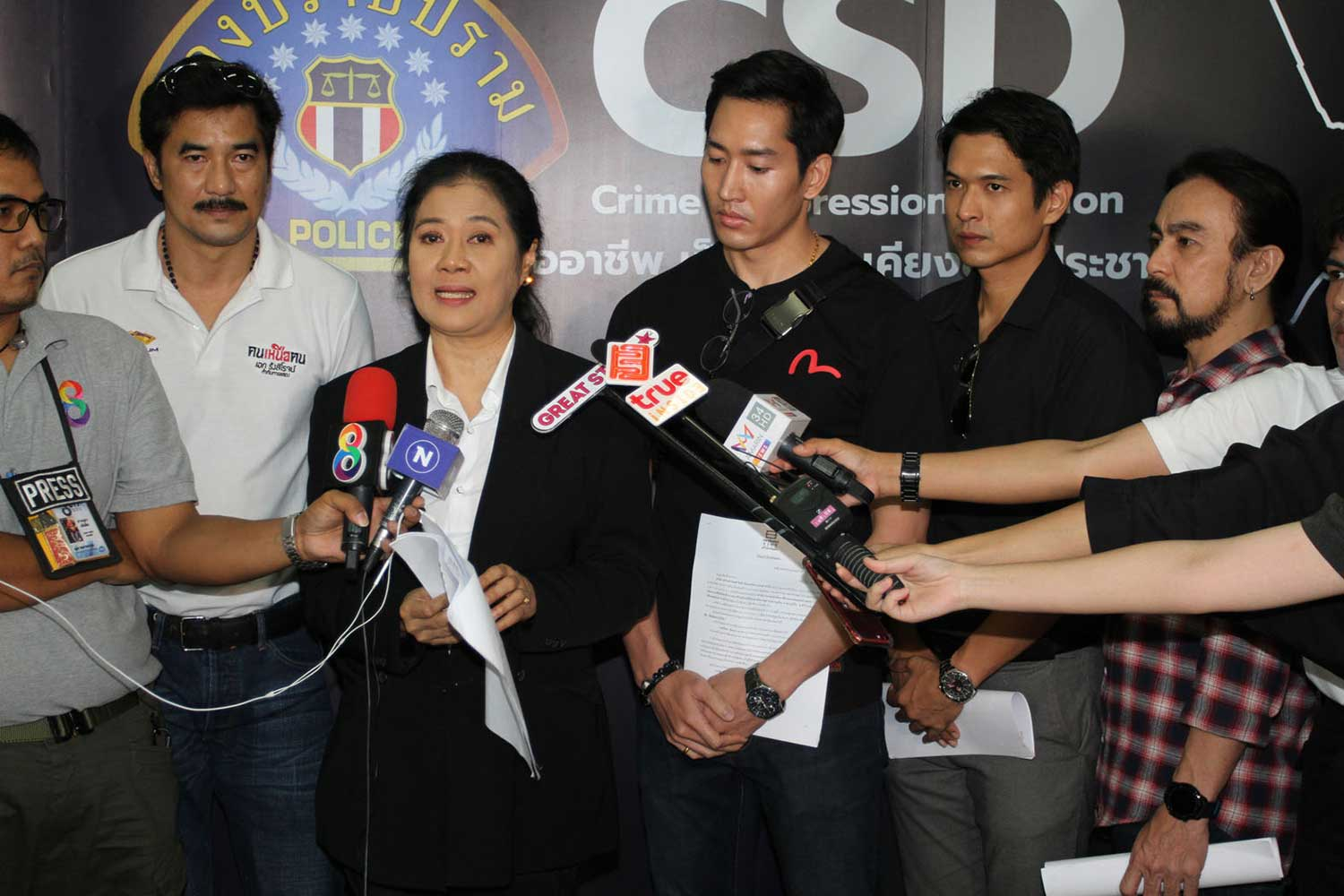 Actress Duanghathai Satthathip speaks to reporters on Thursday after members of the cast of