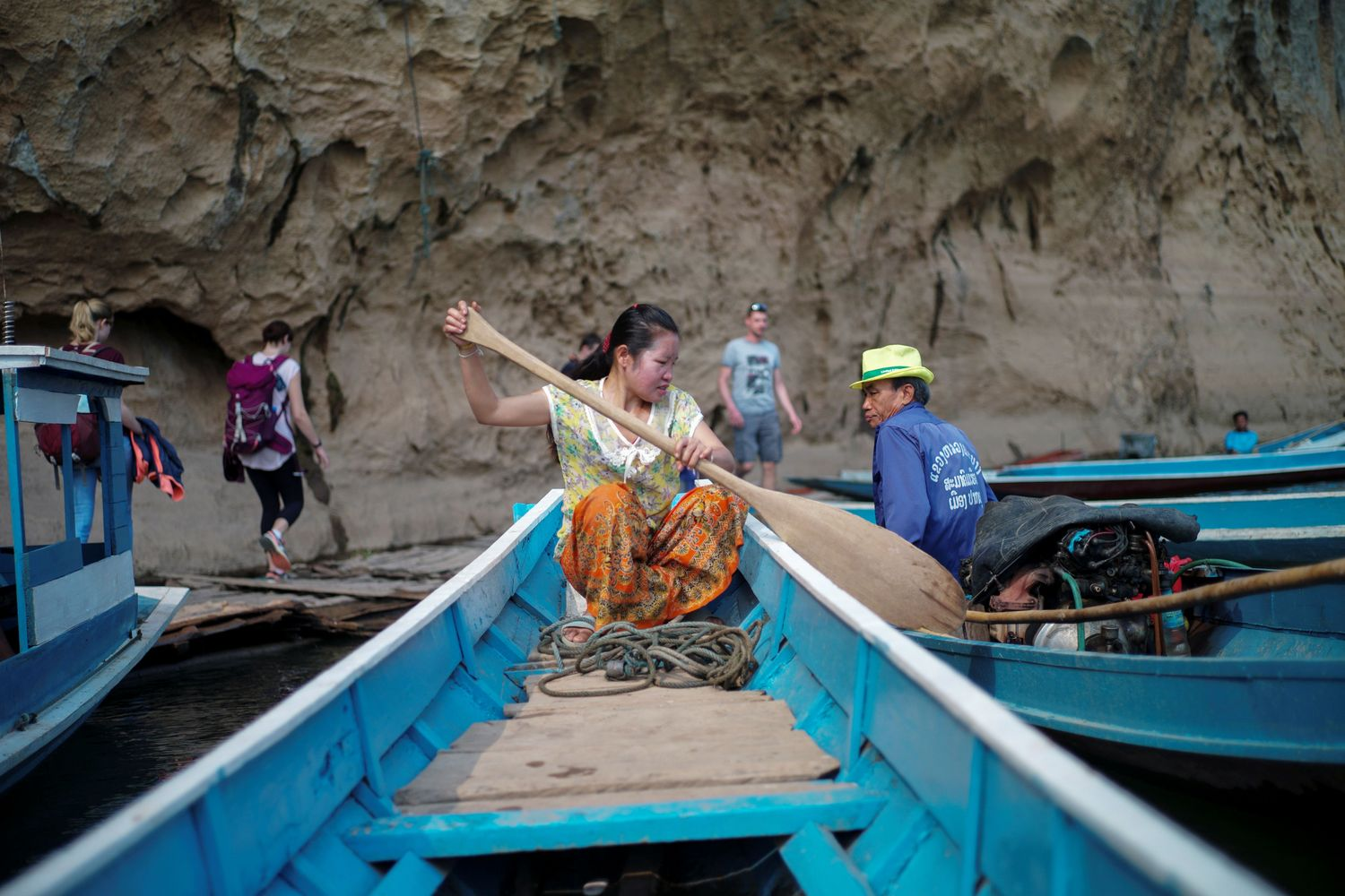 A local villager drive a boat where the future site of the Luang Prabang dam will be on the Mekong River outskirt of Luang Prabang province on Sunday. (Reuters photo)
