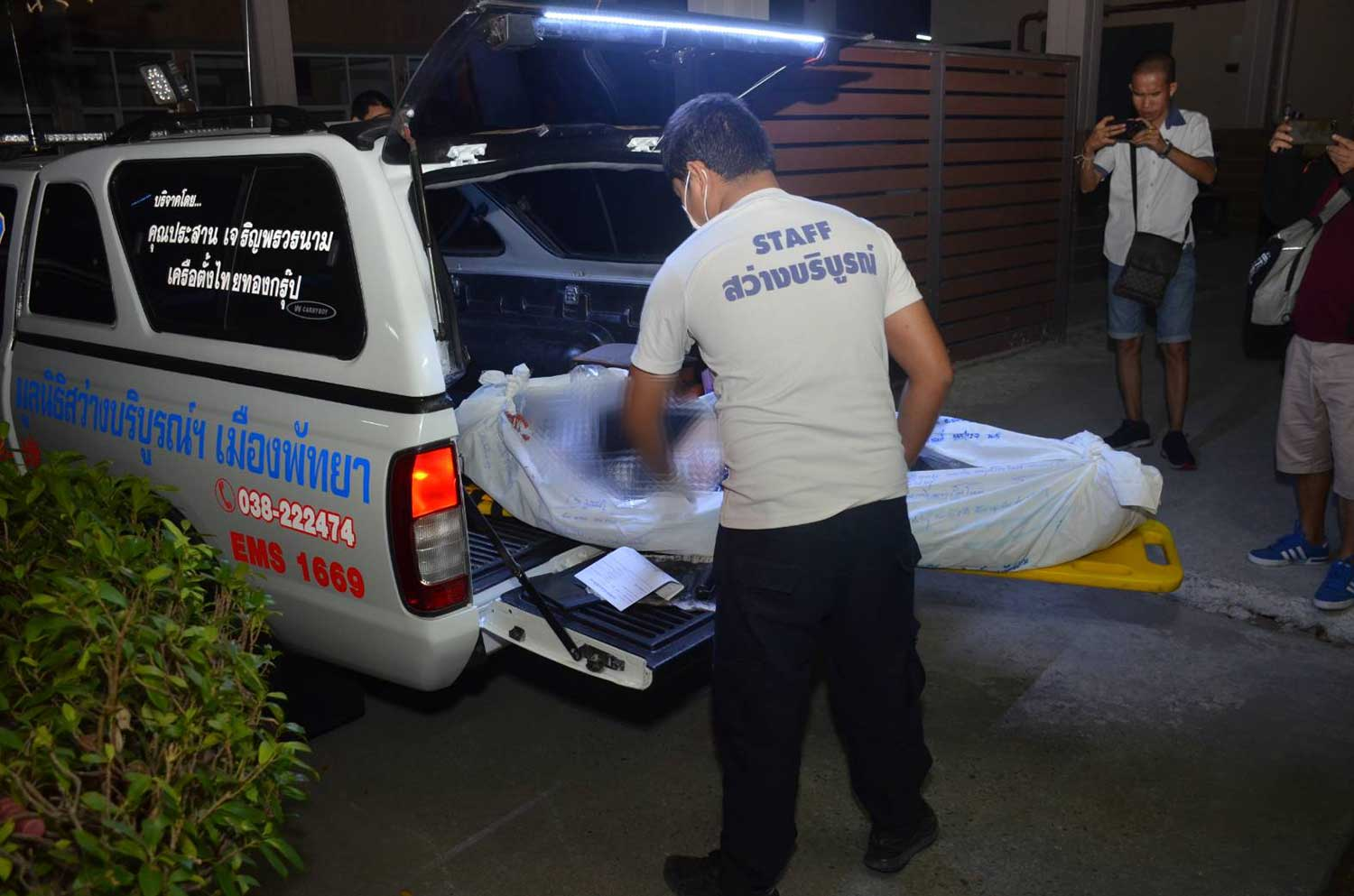 Rescue volunteers take the body of a man of unknown nationality to Bang Lamung Hospital in Pattaya after he was found dead on the ground with broken bones near the entrance of a luxury hotel building in the early hours of Saturday. (Photo by Chaiyot Pupattanapong)