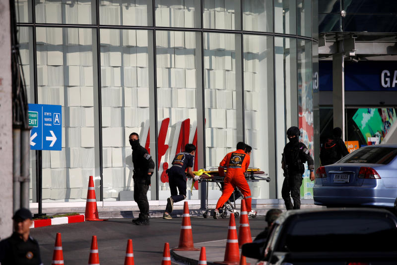 Rescue workers enter the Terminal 21 shopping mall after a soldier went on a shooting rampage in Nakhon Ratchasima, also known as Korat, on Sunday, leaving at least 20 dead. (Reuters photo)