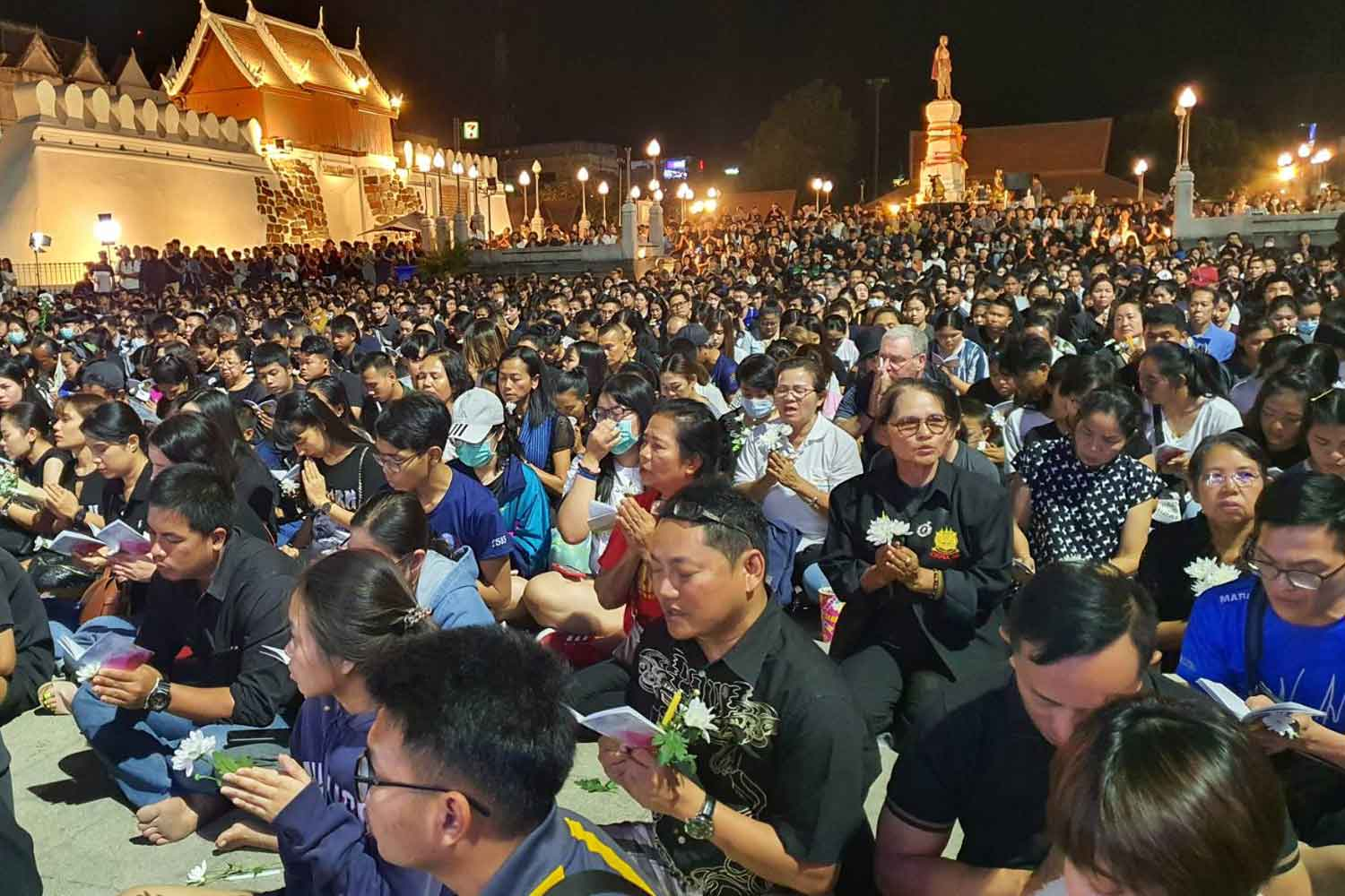 Thousands of local people lit candles and pray for people killed in the shooting rampage in Muang district of Nakhon Ratchasima province on Sunday night. (Photo by Prasit Tangprasert)