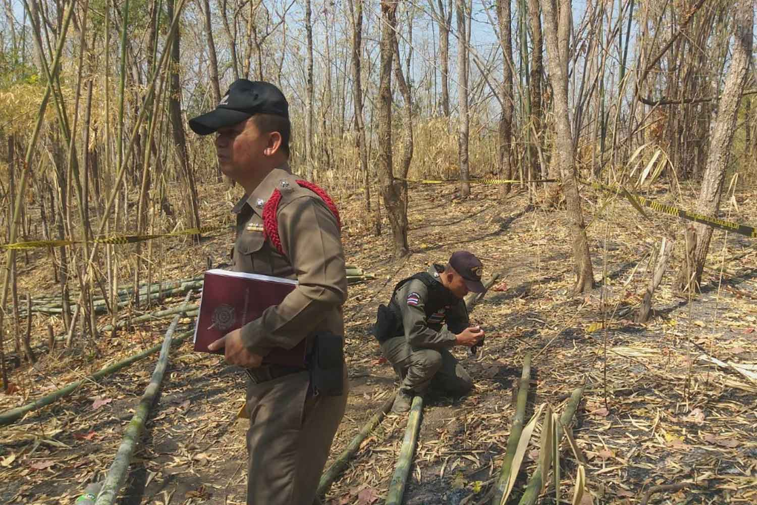 Police collect evidence in a community forest in Phrae's Den Chai district after a land mine exploded, severing a bamboo cutter's right foot on Monday. (Photo supplied)
