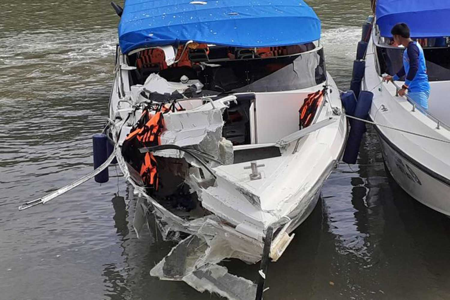 The badly damaged front section of SeaStar Co's 'Panan 5' is seen here after the speedboat collided with another vessel leaving a marina in Phuket on Monday. (Photo by Achadtaya Chuenniran)