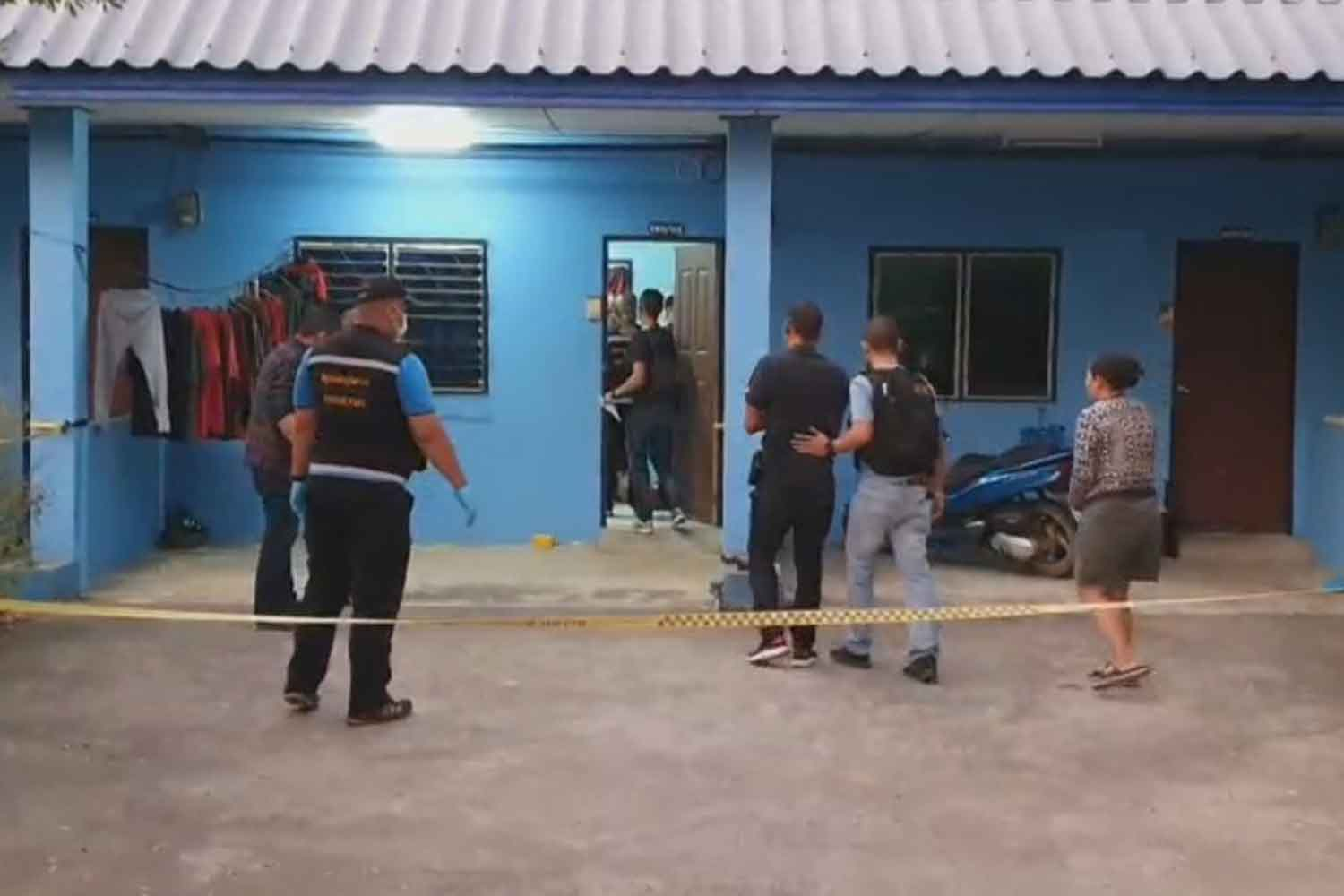 Forensic police at the room where a 17-year-old was shot dead when another youth was  showing off his home-made gun early on Wednesday in Kanchanaburi's Muang district. (Photo by Piyarat Chongcharoen)