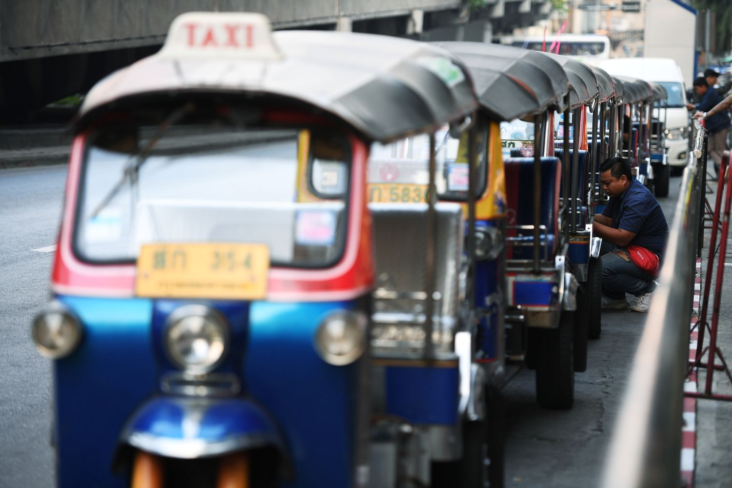 A tuktuk driver waits for his passenger in front of a shopping mall in Bangkok on Monday. (Reuters photo)