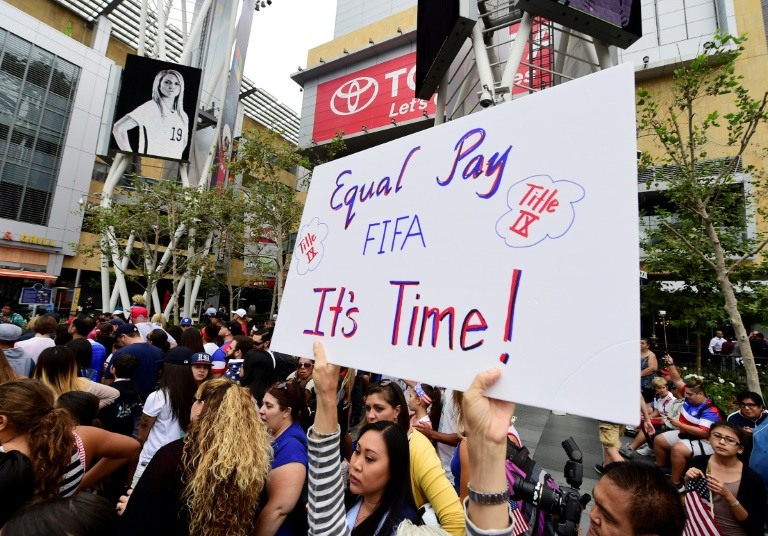 A US women's soccer fan displays a sign calling for equal pay at a rally to celebrate last year's US title run at the Women's World Cup.