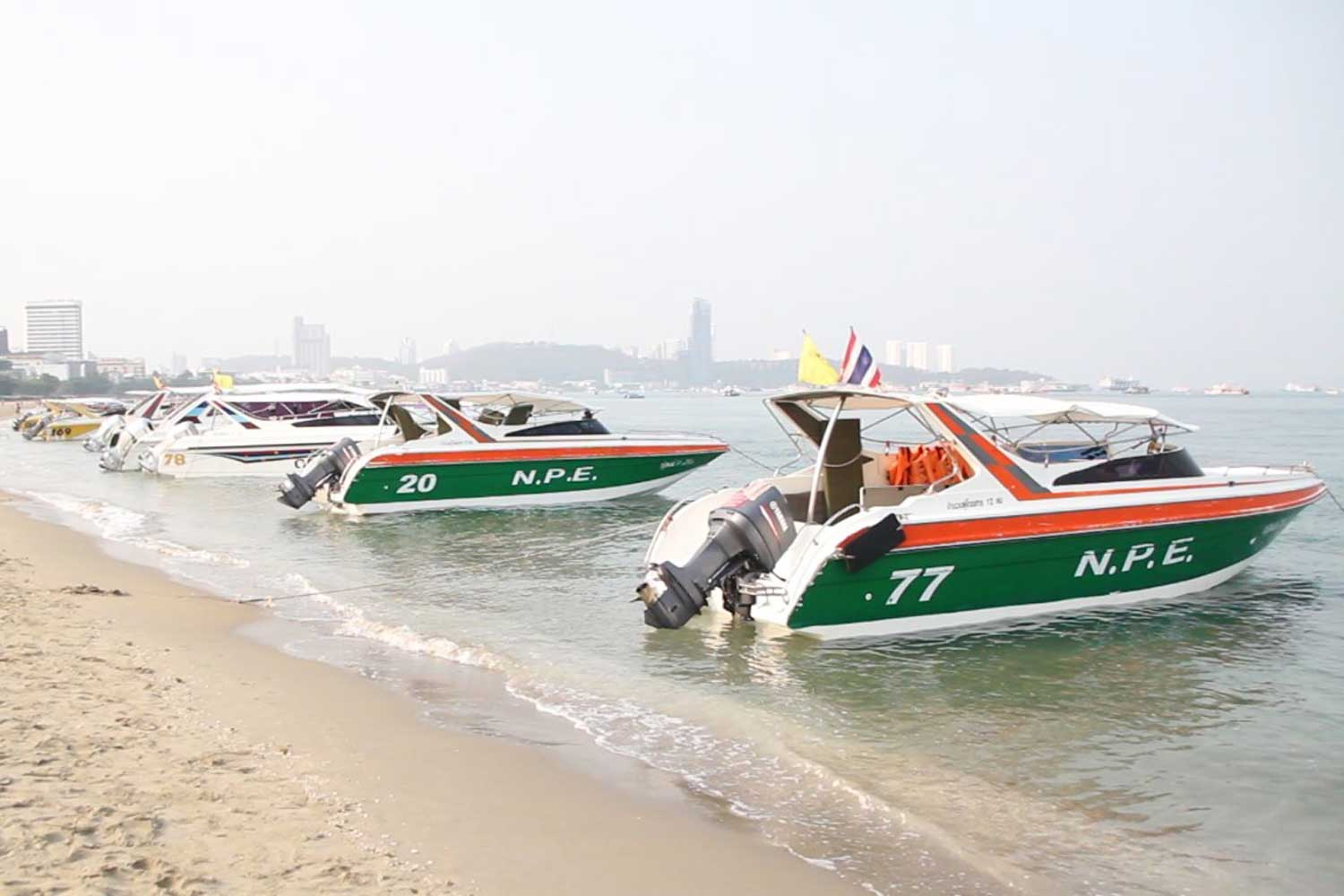 Speedboats wait for tourists on Pattaya beach, Chon Buri. (Photo by Chaiyot Pupattanapong)