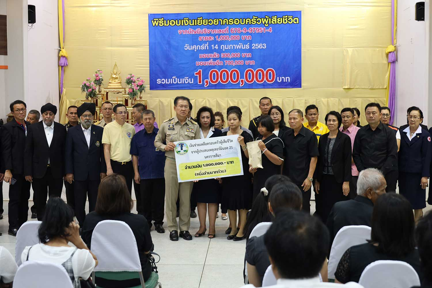 Nakhon Ratchasima governor Wichian Chantharanothai hands over money raised by public donation to the 26 families of 27 victims of the shooting rampage last weekend. Each family has now received one million baht. Total donations have topped 68 million baht and the fund will be closed on Sunday afternoon. (Photo by Prasit Tangprasert)