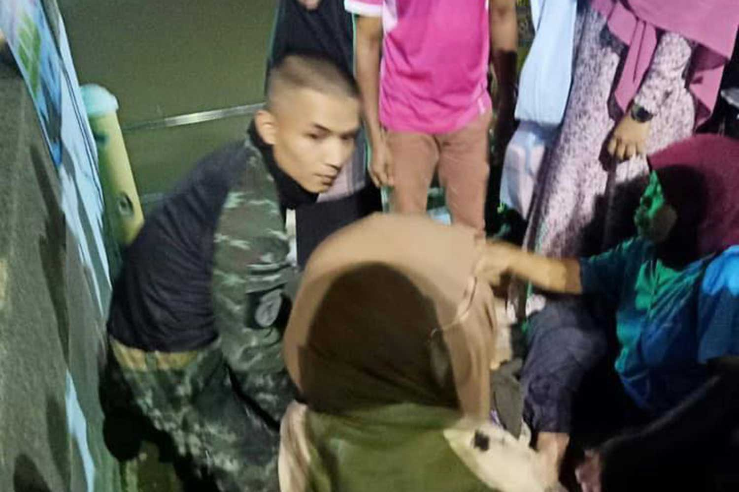 Sgt Khunakorn Sonsrimai takes an 18-year-old woman from the Pattani River in Muang district of Pattani late Friday night. (Photo by Abdullah Benjakat)