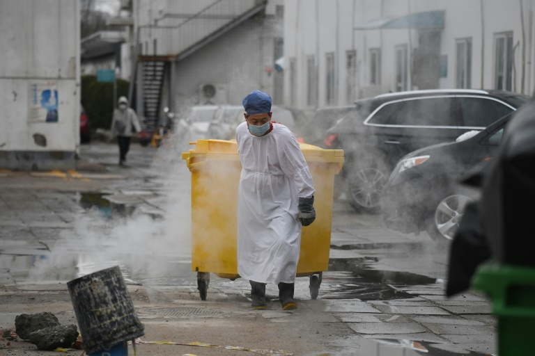 A worker moves medical waste at a hospital in Beijing treating coronavirus patients. (AFP photo)