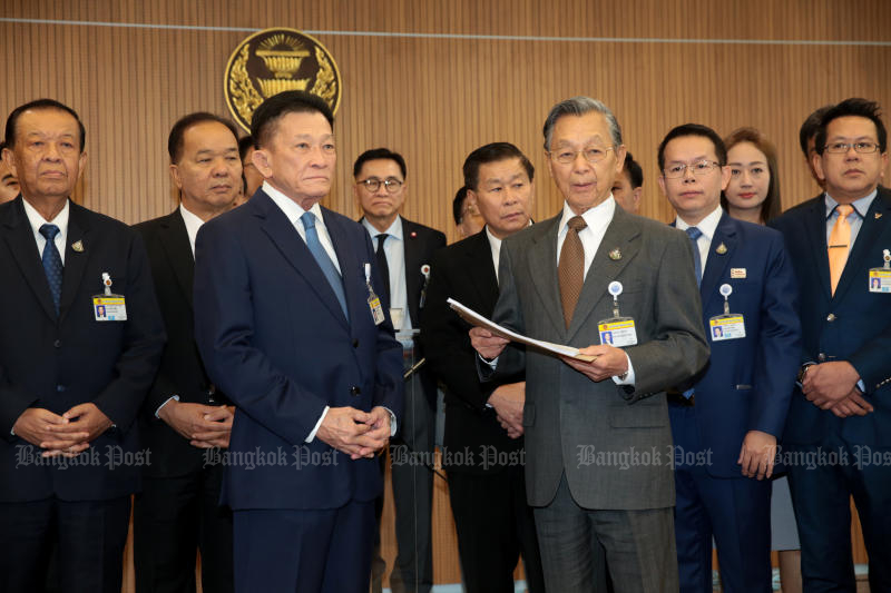 Pheu Thai Party and opposition leader Sompong Amornwiwat, centre left, along with key members of opposition parties, hands a no-confidence motion to Parliament president Chuan Leekpai. The motion targets Prime Minister Prayut Chan-o-cha and five other ministers. (Bangkok Post photo)