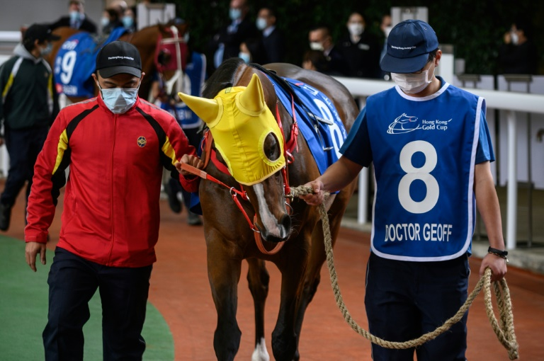 It was a surreal meeting at Sha Tin in front of just 307 spectators, made up entirely of owners and guests, with only the horses not wearing masks
