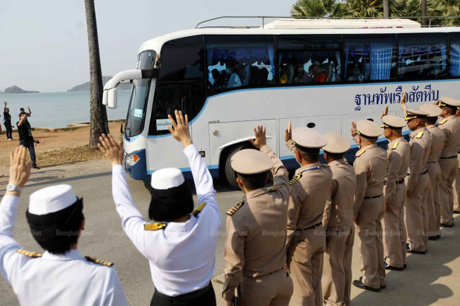 Naval officers see off 137 returnees from Wuhan after their 14-day quarantine ended at the Sattahip naval base in Chon Buri province on Wednesday. (Photo by Wichan Charoenkiatpakul)