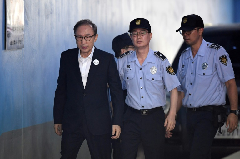 Former South Korean president Lee Myung-bak arriving at court to attend his original trial in 2018.
