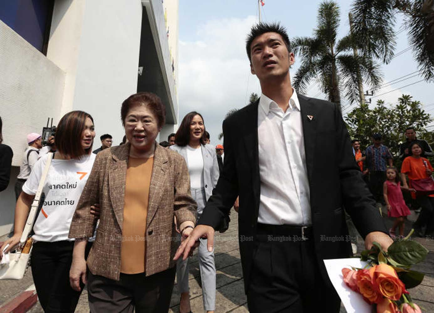 Future Forward Party leader Thanathorn Juangroongruangkit, right, is escorted by his mother Somporn at the Office of the Attorney-General in Bangkok early last year. (Bangkok Post file photo)