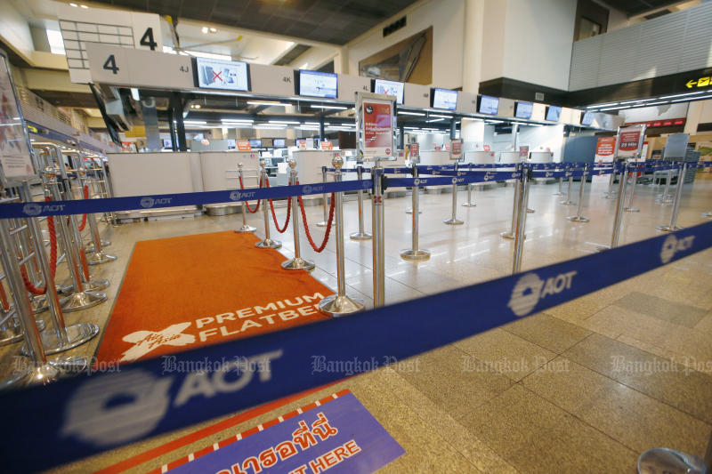 Don Mueang airport is quiet as the coronavirus outbreak hits the tourism sector and Airports of Thailand Plc. AOT shares plunged 4.8% to 64.50 baht on Thursday. (Photo by Pornprom Satrabhaya)