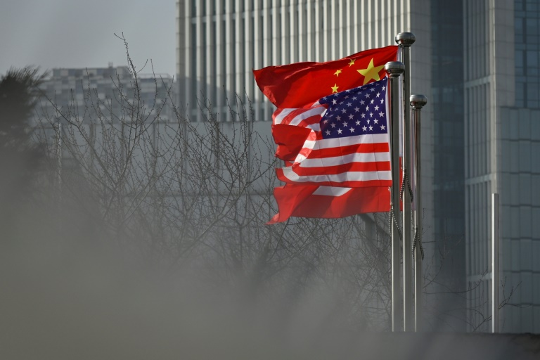 China has expelled three Wall Street Journal reporters over an op-ed headline in the newspaper that it deemed racist.