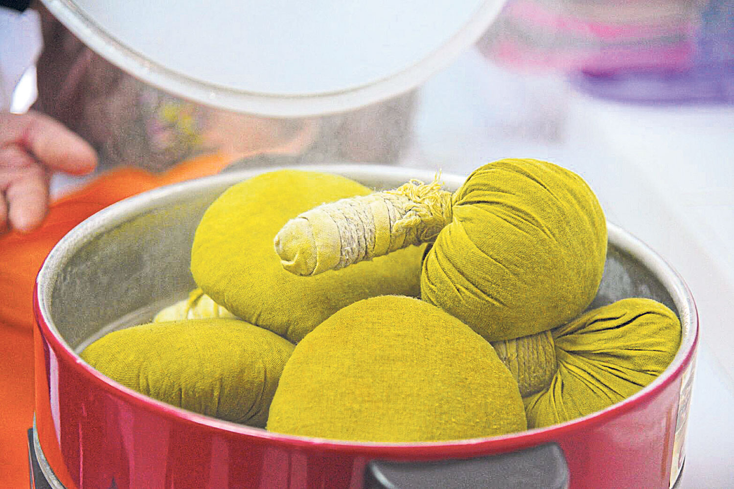 'Luk pra kob' balls stuffed with herbs are used for massaging elderly folk who need physiotherapy.