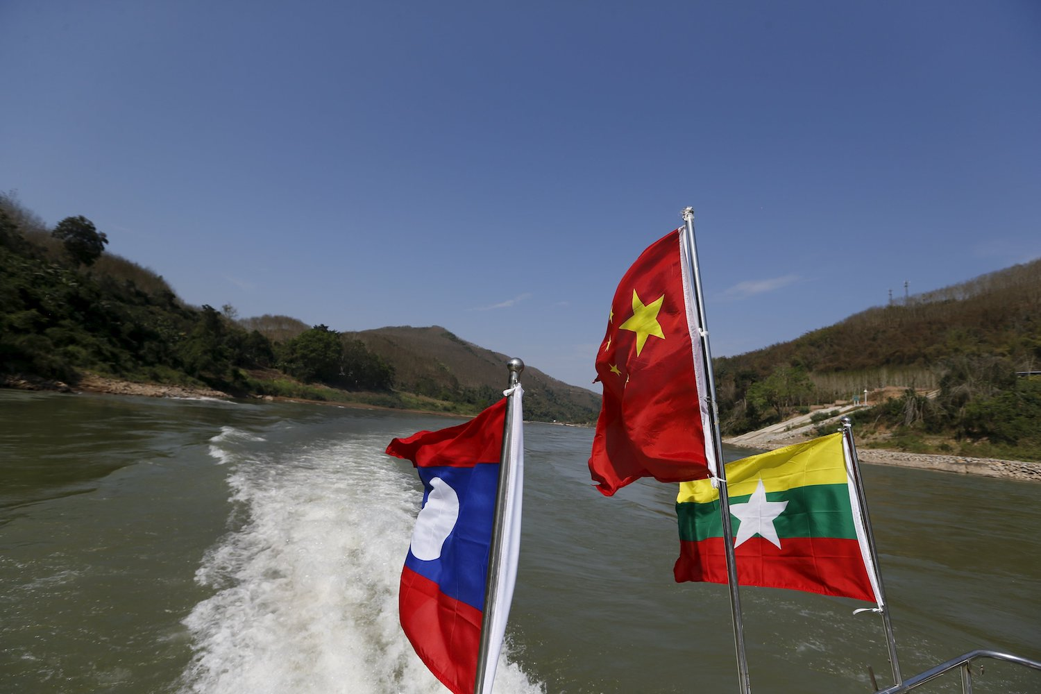 Flags flutter on a boat making an inspection trip on the Mekong river near the border between China, Laos and Myanmar. (Reuters File Photo)