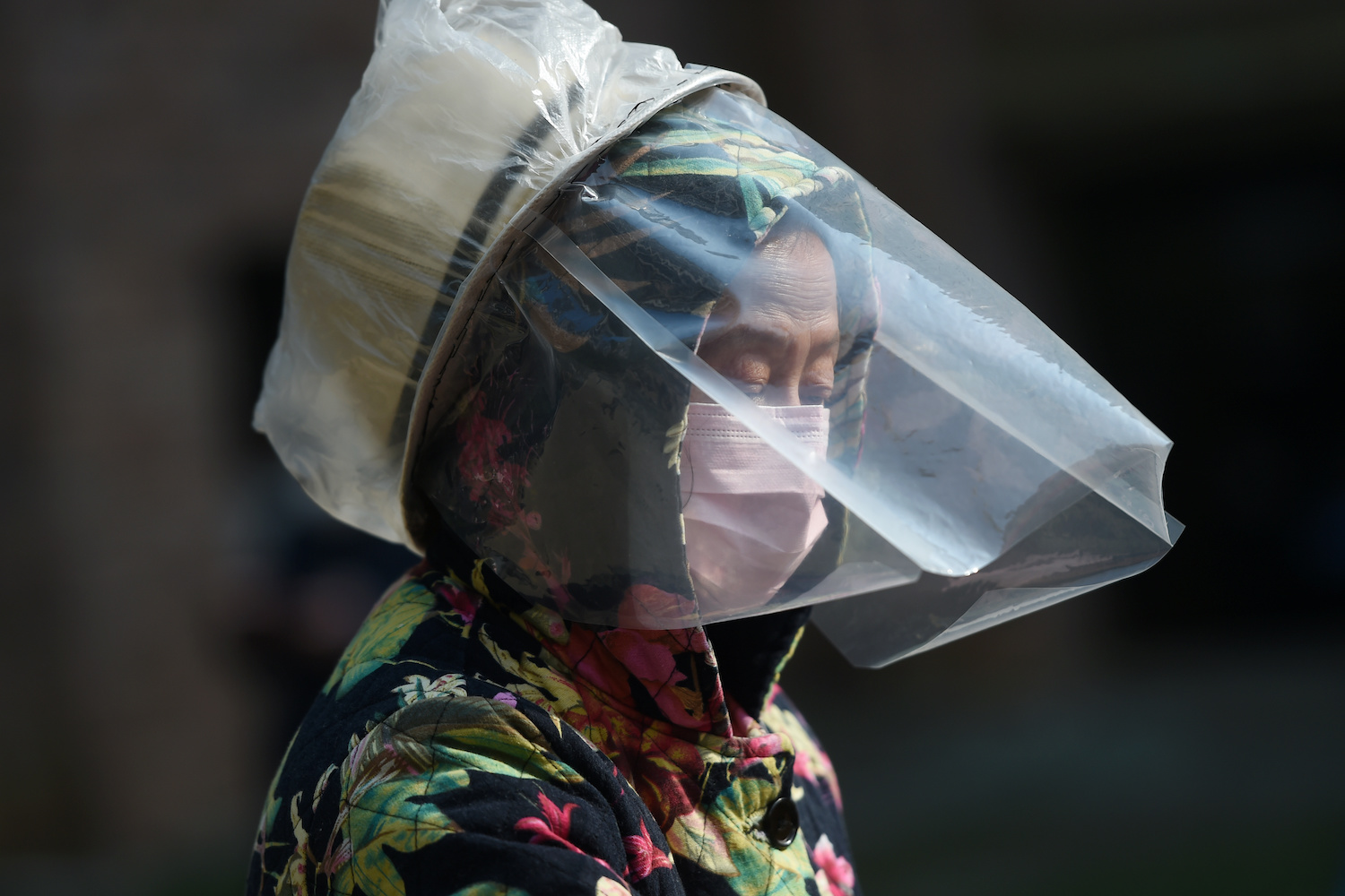 A resident wears a makeshift protective face shield at a residential compound in Wuhan on Friday. (Reuters Photo)