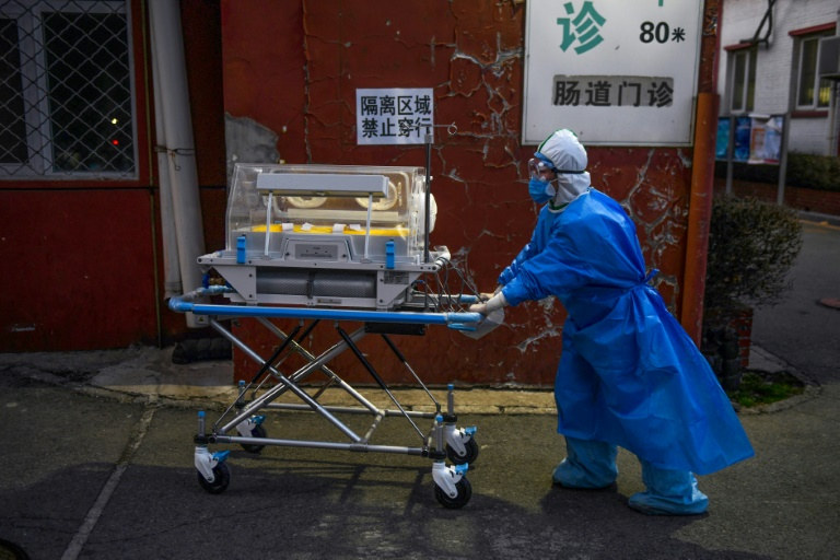 China announces biggest drop in new virus cases in nearly  a month