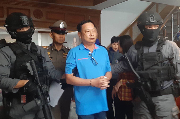 Former MP for Nakhon Sawan Pol Lt Col Banyin Tangpakorn is arrested by the Crime Suppression Division at his house in Muang district of the central province on Sunday. (Crime Suppression Division photo)
