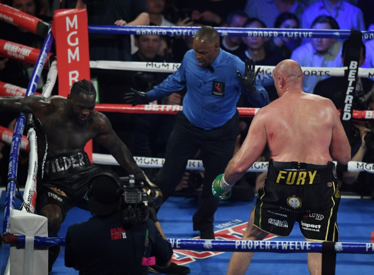 British boxer Tyson Fury, right, knocks American Deontay Wilder down before stopping him in the seventh round during their World Boxing Council heavyweight championship fight in front of a crowd of 15,800 at the MGM Grand Garden Arena in Las Vegas.