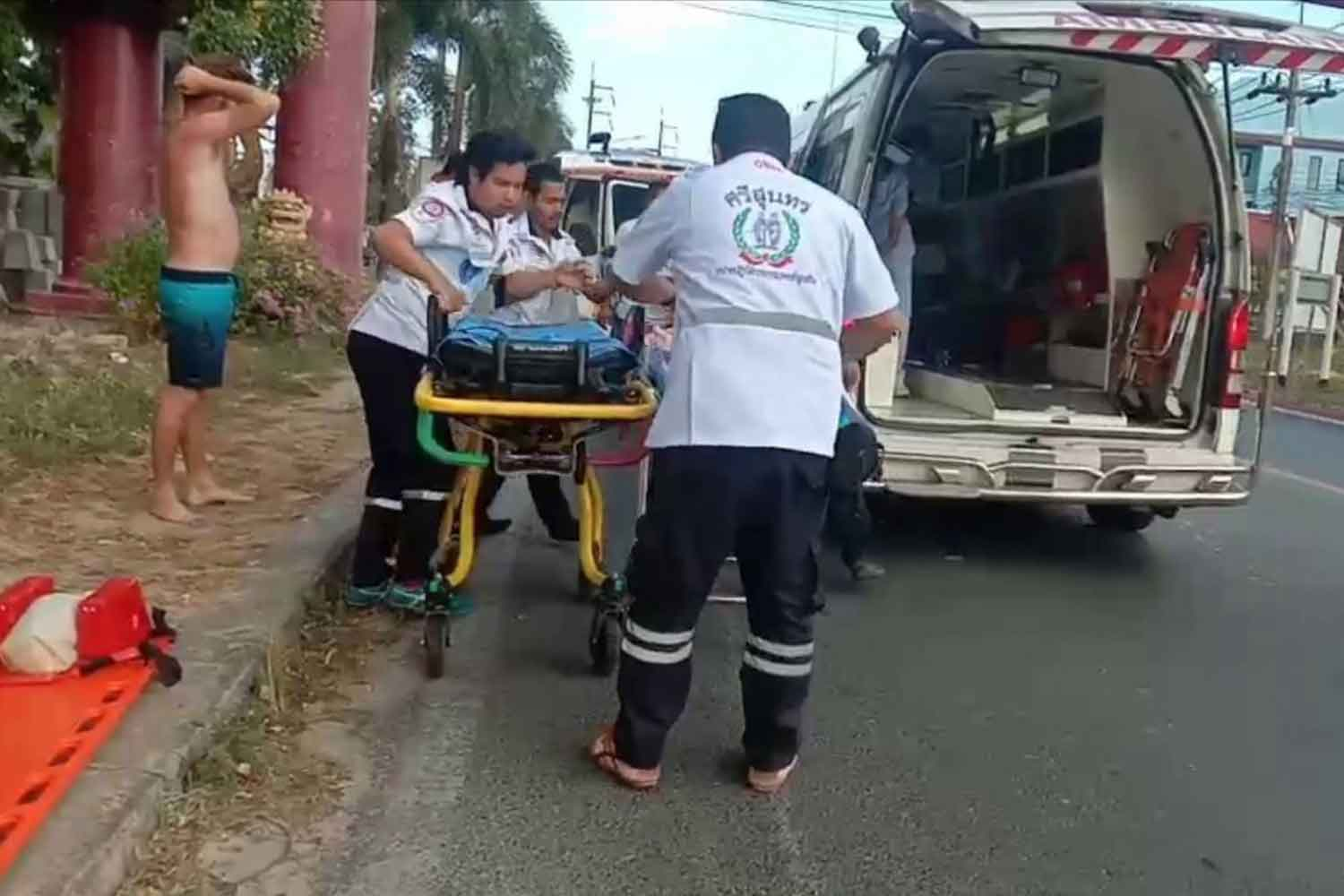Rescuers place the unconscious young boy in an ambulance for transpoprt to Thalang Hospital in Phuket after he fell into a pool at a water park on Sunday. At the hospital, he was pronounced dead from drowning. (Photo by Achadtaya Chuenniran)