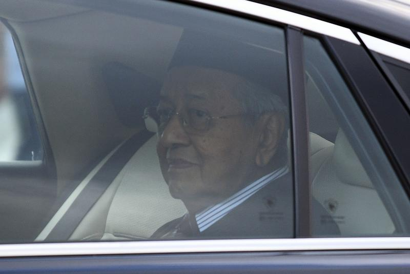 Malaysia's former prime minister Mahathir Mohamad looks on as he leaves the National Palace in Kuala Lumpur on Monday. (AFP photo)