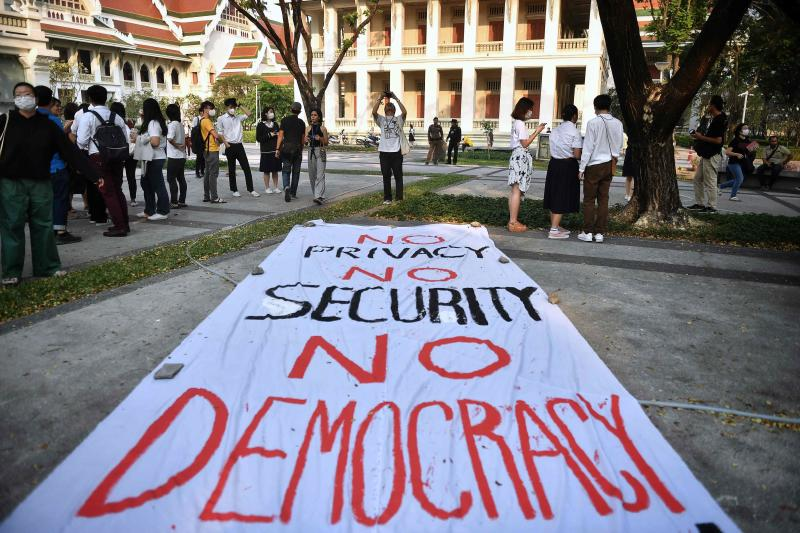 Students gather at a pro-democracy rally against military rule and the Constitutional Court's ruling to dissolve the progressive opposition Future Forward Party, at Chulalongkorn University in Bangkok on Monday. (AFP photo)