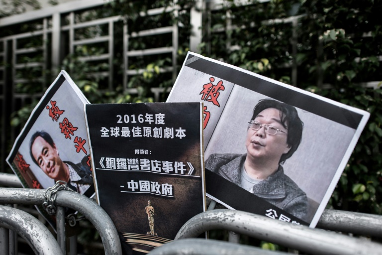 Gui Minhai (right), one of five Hong Kong-based booksellers known for publishing salacious titles about Chinese political leaders was snatched by Chinese authorities while on a train to Beijing in February 2018.