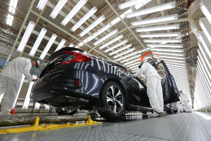Mechanics work on the Honda assembly line in Prachin Buri in 2016. (Bangkok Post file photo)