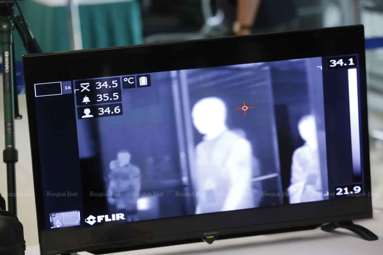Thermal scanning is seen in place at Suvarnabhumi airport. A Thai returnee from Japan reportedly has Covid-19 but he initially denied his overseas trip. (Photo by Pornprom Satrabhaya)