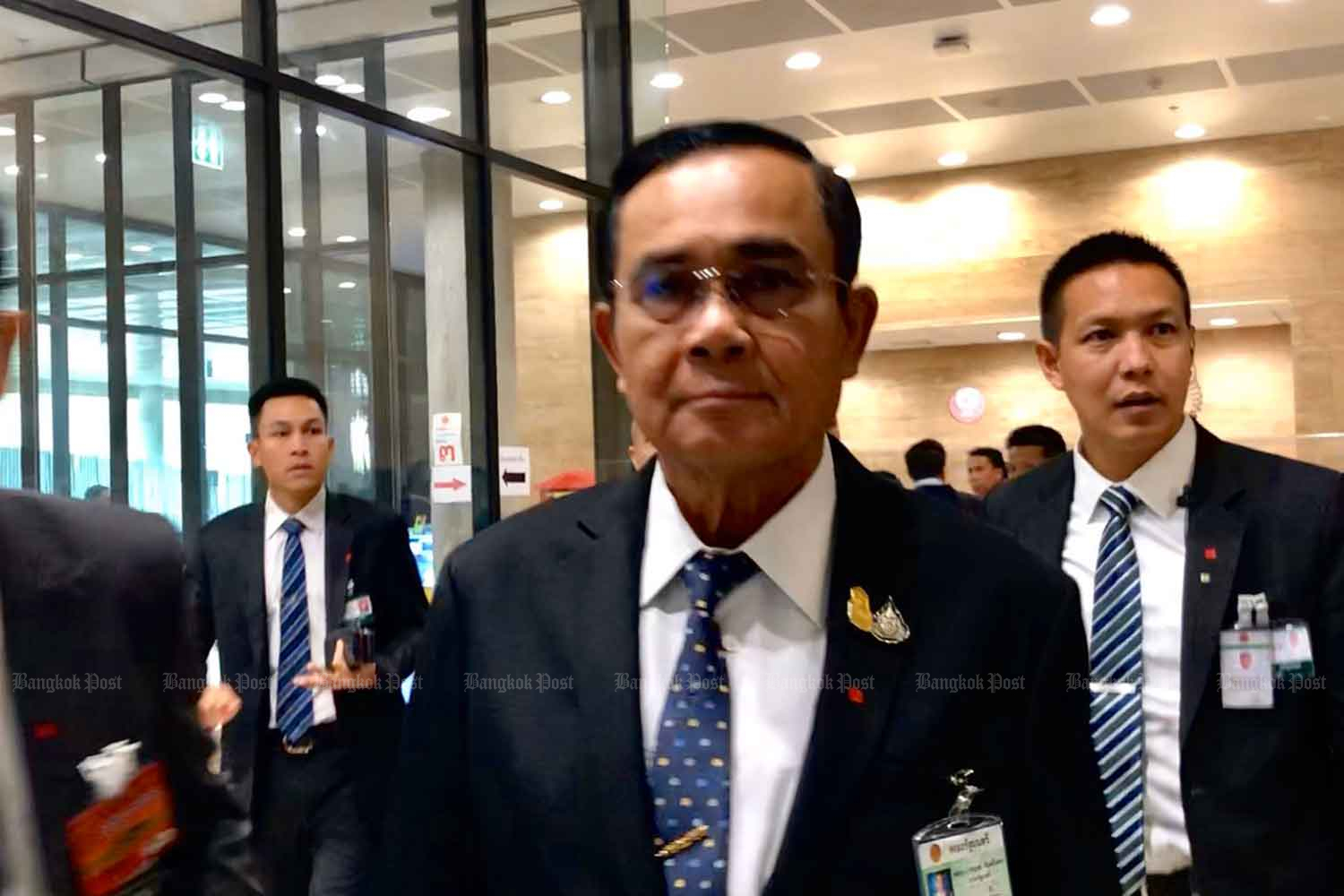 Prime Minister Prayut Chan-o-cha arrives at the parliament in Bangkok on Thursday. (Photo by Wassana Nanuam)