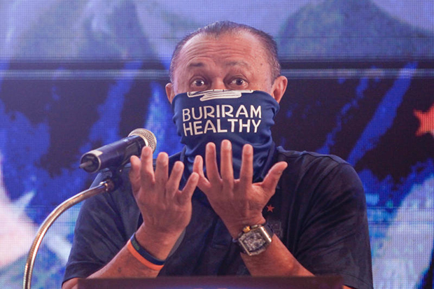 Former Buri Ram politician Newin Chidchob makes a point of wearing a face mask at a promotion on Thursday for the OR Thailand Grand Prix 2020 at the Chang International Circuit in late March. (Photo supplied)