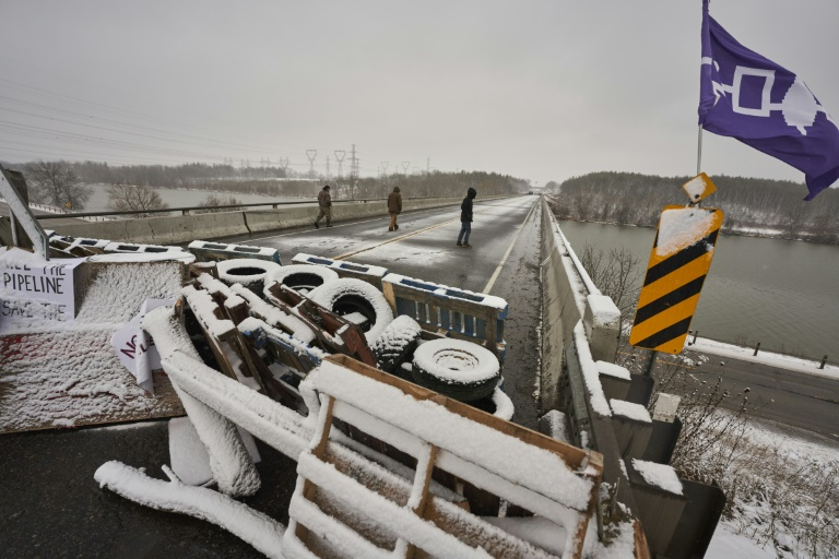 First Nations protestors walk on a bridge past their barricade on Highway 6 near Caledonia, Ontario which the protestors set up in support of the Wet'suwet'en hereditary chiefs and the Tyendinaga Mohawks on February 26, 2020