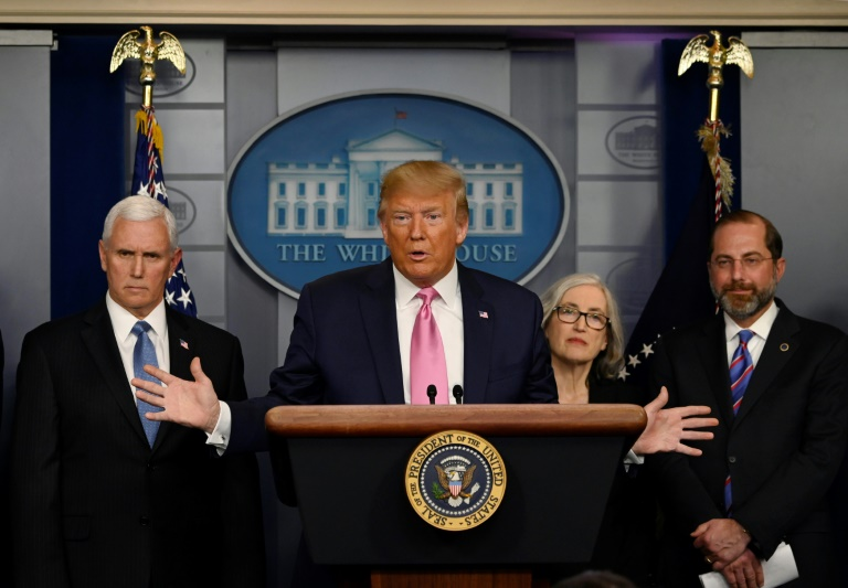 US President Donald Trump, flanked by Health and Human Services Secretary Alex Azar (right), US Vice President Mike Pence (left) and CDC Principal Deputy Director Anne Schuchat, holds a news conference on the COVID-19 outbreak.