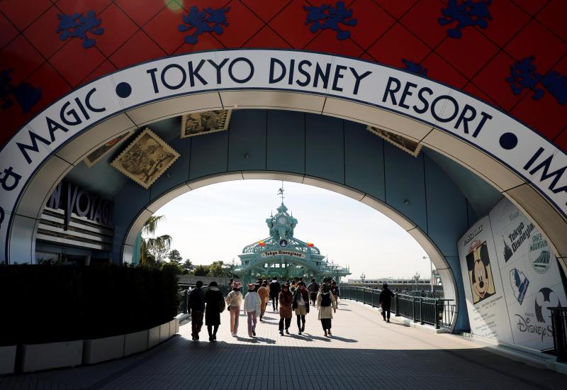 Visitors outside Tokyo Disneyland in Urayasu, east of Tokyo, on Friday. (Reuters photo)