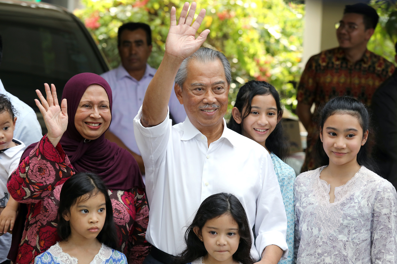 Former interior minister Muhyiddin Yassin waves to reporters outside his residence in Kuala Lumpur on Saturday after being named prime minister by Malaysia's king. (Reuters Photo)