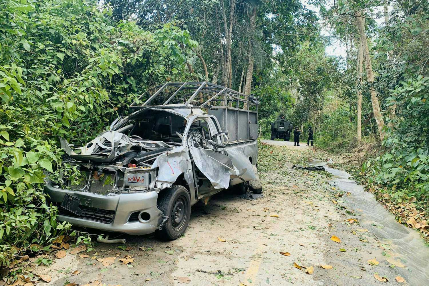 A heavily damaged military truck sits on a road in Bacho district of Narathiwat on Friday evening after an explosion that killed one ranger and wounded five others. (Photo by Waedao Harai)