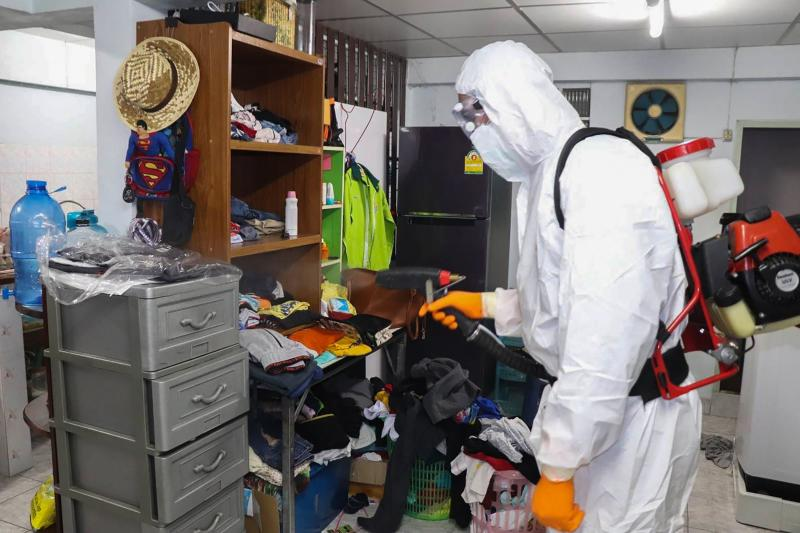 FILE PHOTO: This handout photo taken and released by Bangkok Metropolitan Administration's health department on Thursday shows a government health personnel wearing protective clothing disinfecting a house after family members were infected with Covid-19 coronavirus in Bangkok.  (AFP/Bangkok Metropolitan Administration photo)